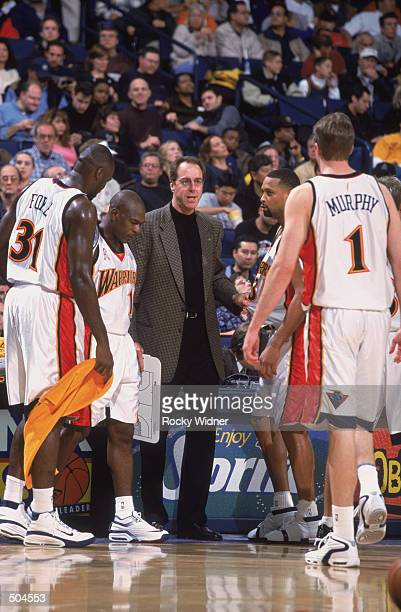 Portrait of head coach Dave Cowens of the Golden State Warriors with the team during the NBA game against the New Jersey Nets at the Arena in Oakland...