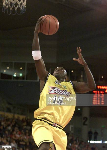 Randy Rutherford for the Bullets slam dunks one of his 23 first half points during the NBL match between the Melbourne Tigers and the Brisbane...