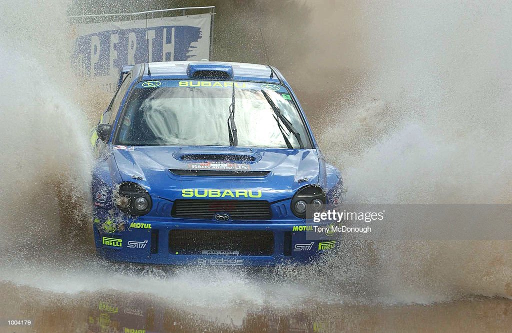Richard Burns and co-driver Robert Reid put their Subaru Impreza WRC 2001 through the water jump in the 4.19 km outback bush tracks around the Sotico Special Stage to take 2nd position of the Telstra Rally Australia at Perth, Australia. DIGITAL IMAGE Mandatory Credit: Tony McDonough/ALLSPORT