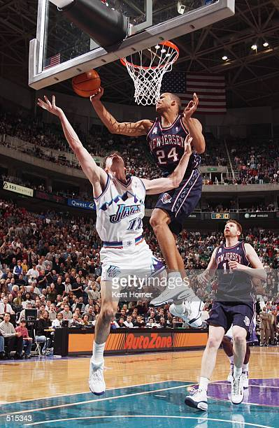 Richard Jefferson of the New Jersey Nets goes to the basket defended by John Stockton of the Utah Jazz during their game at Delta Center in Salt Lake...