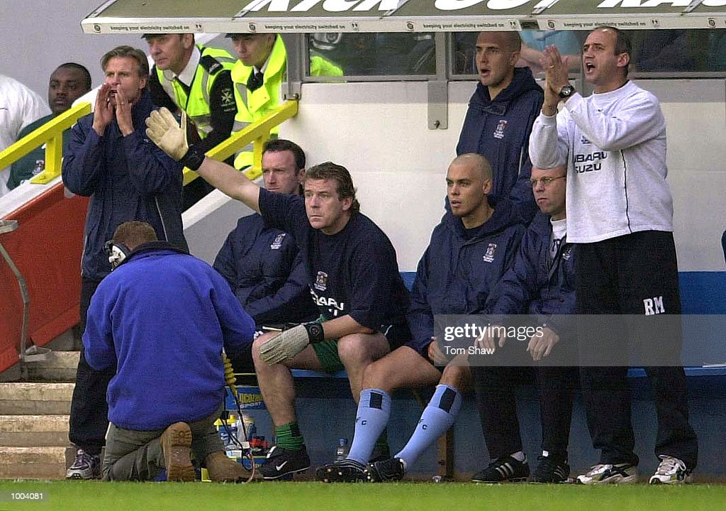 Roland Nillson, the Coventry manager (right), shouts instuctions from the bench during the Millwall v Coventry City Nationwide League Division One match at the New Den, London. DIGITAL IMAGE. Mandatory Credit: Tom Shaw/ALLSPORT