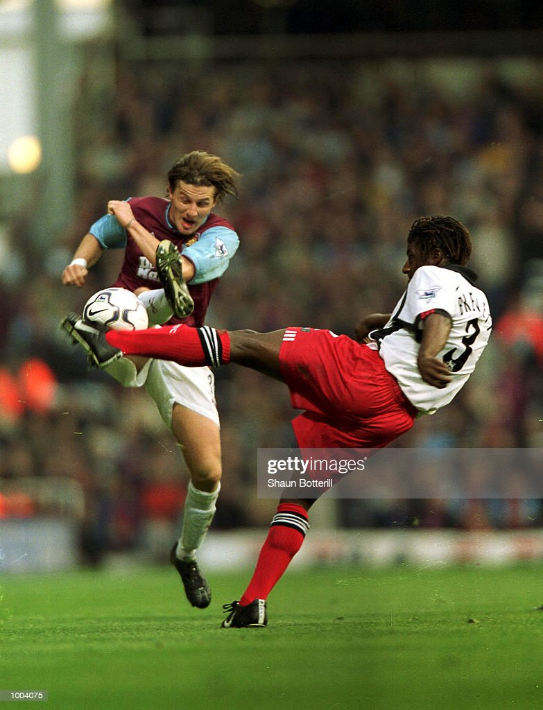 Rufus Brevett of Fulham and Sebastian Schemmel of West Ham in action during the FA Barclaycard Premiership match between West Ham United and Fulham at Upton Park, London. Mandatory Credit: Shaun Botterill/ALLSPORT