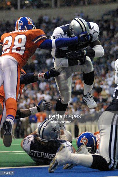 Running back Troy Hambrick of the Dallas Cowboys leaps in for a touchdown past Kenoy Kennedy of the Denver Broncos during the second half at Texas...