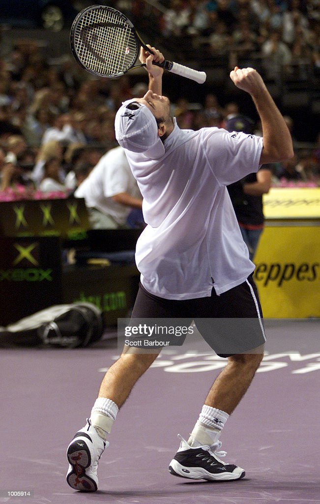 Sebastien Grojean of France celebrates a point during his victory over Andre Agassi of USA during day four of the Tennis Masters Cup held at the Sydney Superdome in Sydney, Australia. DIGITAL IMAGE. Mandatory Credit: Scott Barbour/ALLSPORT