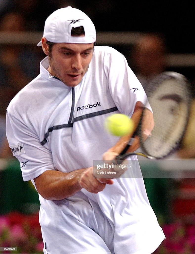 Sebastien Grosjean of France in action against Andre Agassi of the United States during the Tennis Masters Cup held at the Sydney Superdome, Sydney, Australia. DIGITAL IMAGE Mandatory Credit: Nick Laham/ALLSPORT