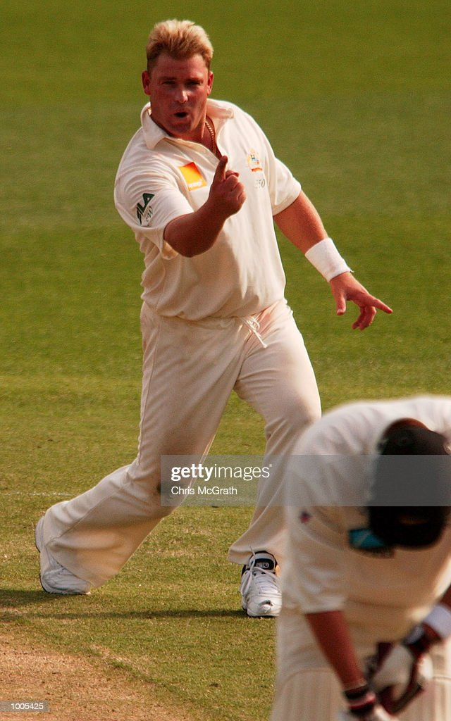 Shane Warne of Australia clebrates claiming the wicket of Mark Richardson of New Zealand during day five of the first cricket test between Australia and New Zealand held at the Gabba, Brisbane, Australia, DIGITAL IMAGE Mandatory Credit: Chris McGrath/ALLSPORT