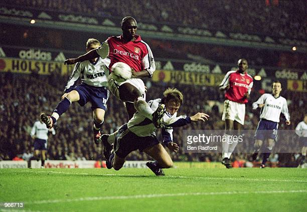 Sol Campbell of Arsenal gets a challenge in on Spurs'' Teddy Sheringham during the FA Barclaycard Premiership match between Tottenham Hotspur and...