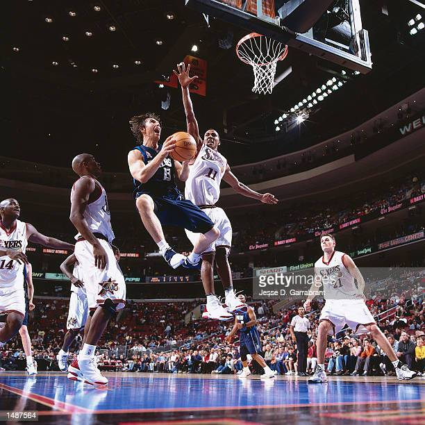 Steve Nash of the Dallas Mavericks drives to the basket against Raja Bell of the Philadelphia 76ers during a NBA Game at the First Union Center in...