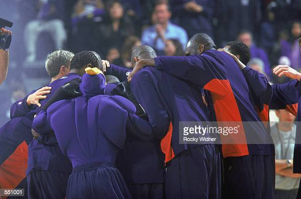The Golden State Warriors team huddle before the NBA game against the New Jersey Nets at the Arena in Oakland in Oakland California The Warriors...