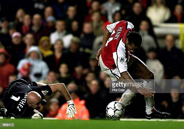 Thierry Henry of Arsenal beats Manchester Keeper Fabien Barthez during the FA Barclaycard Premiership match between Arsenal and Manchester United at...