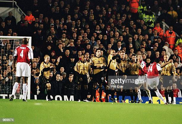 Thierry Henry of Arsenal takes a freekick as Manchester United line up a defensive wall during the FA Barclaycard Premiership match played at...