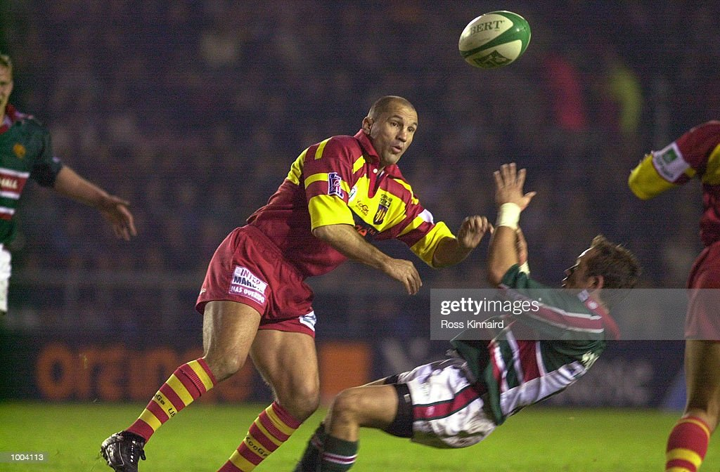 Thierry Lacroix of Perpignan challenged by Jamie Hamilton of Leicester during the Leicester Tigers v Perpignan Heineken Cup match at Welford Road, Leicester. DIGITAL IMAGE. Mandatory Credit: Ross Kinnaird/ALLSPORT