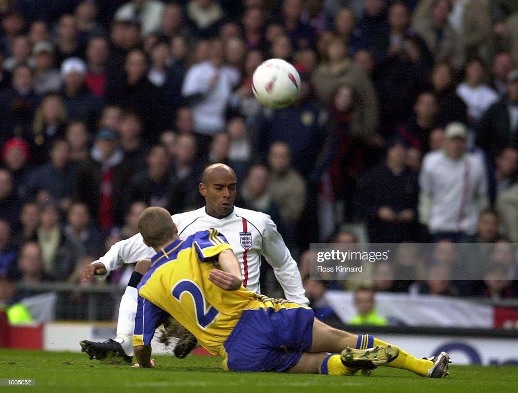 Trevor Sinclair of England battles with Christoffer Andersson of Sweden during the England v Sweden International friendly at Old Trafford, Manchester. DIGITAL IMAGE Mandatory Credit: Ross Kinnaird/ALLSPORT