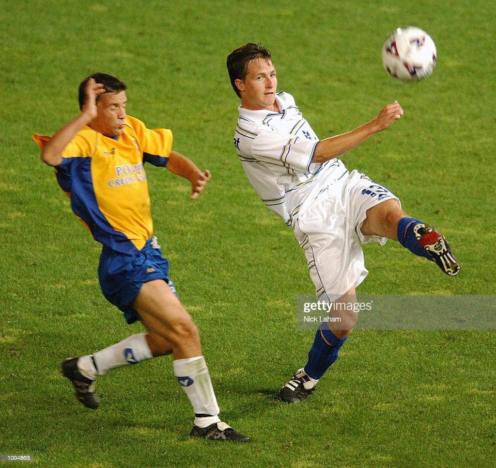 Wayne Heath #13 of the Strikers clears the ball during the NSL match between the Parramatta Power and the Brisbane Strikers held at Parramatta Stadium, Sytdney, Australia. Strikers 2 defeated the Power 1. DIGITAL IMAGE Mandatory Credit: Nick Laham/ALLSPORT