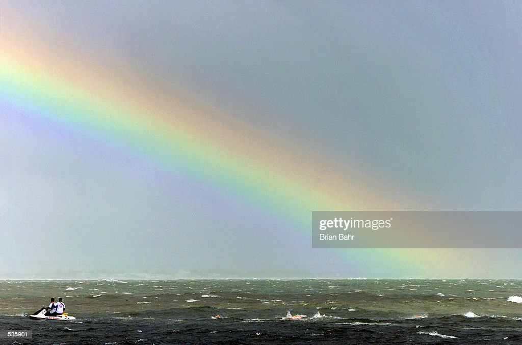 Women triathletes swim in choppy waters caused by Hurricane Michelle as a rainbow appears in the passing storm during the ITU Triathlon World Cup in Cancun, Mexico. DIGITAL IMAGE Mandatory Credit: Brian Bahr/ALLSPORT