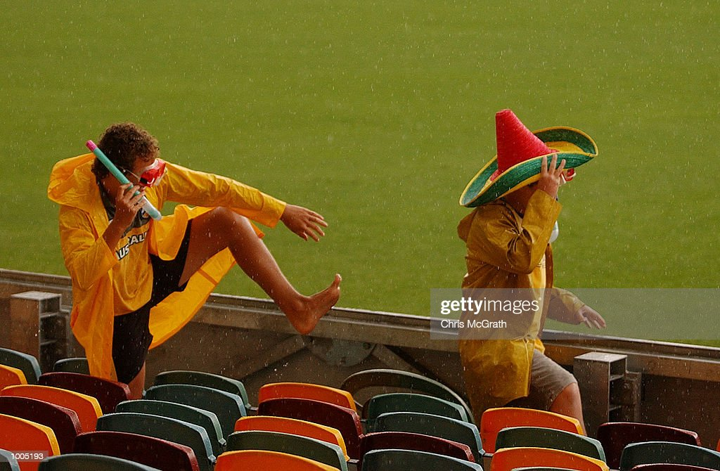 Young cricket fans enjoy the puddles after a thunderstorm stopped play during day four of the first cricket test between Australia and New Zealand held at the Gabba, Brisbane, Australia, DIGITAL IMAGE Mandatory Credit: Chris McGrath/ALLSPORT