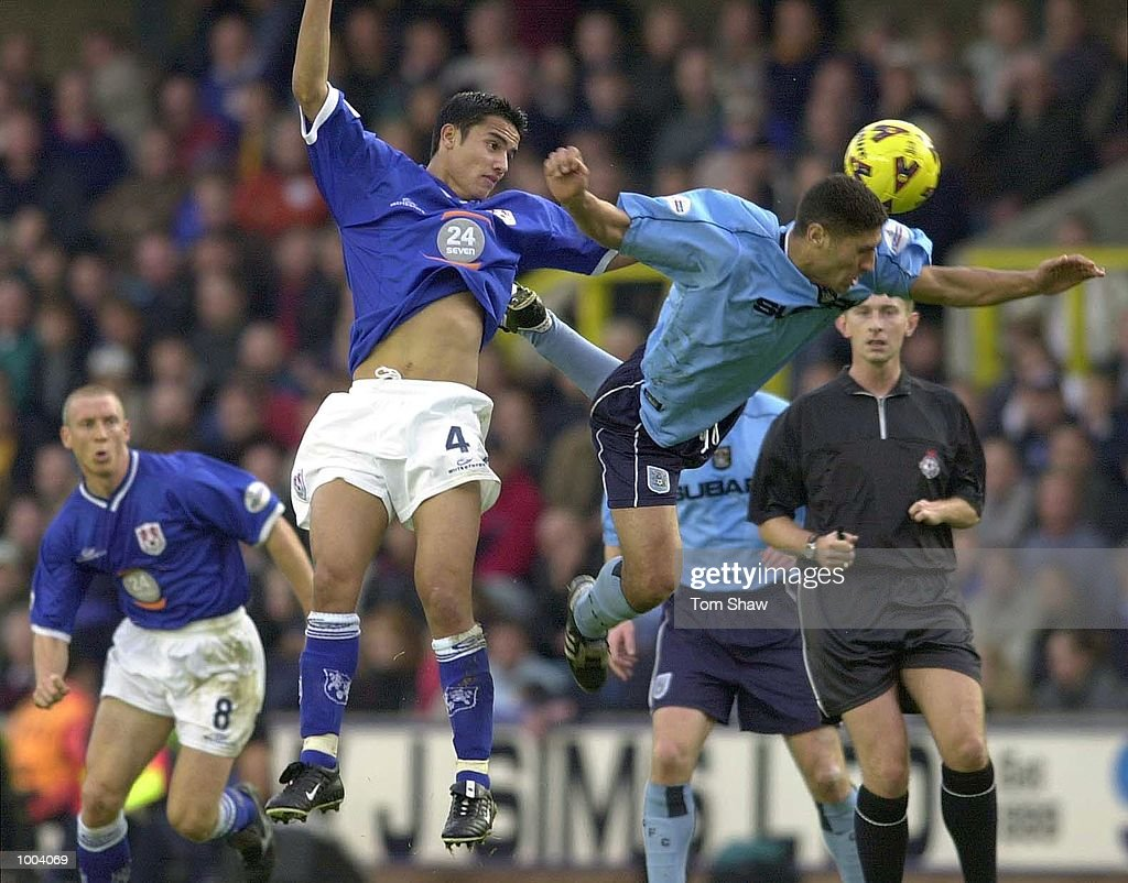 Youssef Safri of Coventry beats Tim Cahill of Millwall to the ball during the Millwall v Coventry City Nationwide League Division One match at the New Den, London. DIGITAL IMAGE. Mandatory Credit: Tom Shaw/ALLSPORT