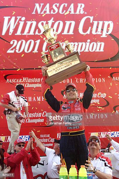 Jeff Gordon celebrates winning the championship at the NASCAR Winston Cup NAPA 500 at the Atlanta Motor Speedway in Hampton Georgia Digital Image...