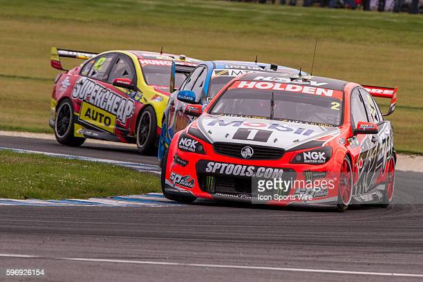 Garth Tander of the Holden Racing Team leads Mark Winterbotom of the Pepsi Max Crew and Tim Slade of Supercheap Auto Racing during Race 1 for the V8...