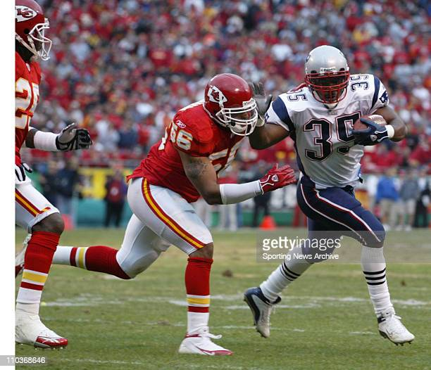 Nov 27 2005 Kansas City MO USA The Kansas City Chiefs DERRICK JOHNSON against the New England Patriots PATRICK PASS at Arrowhead Stadium in Kansas...