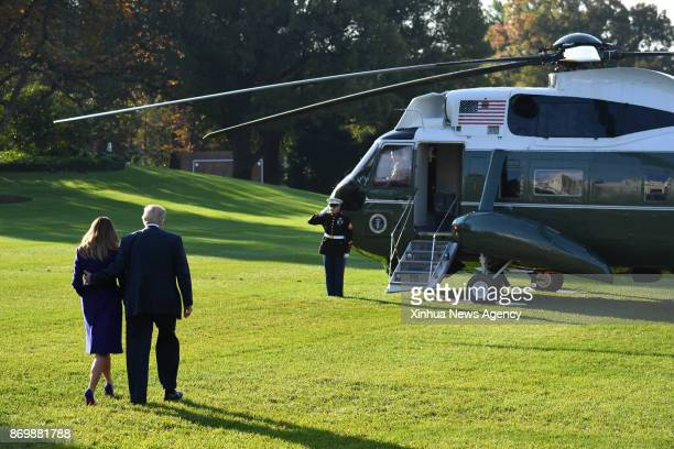 WASHINGTON Nov 3 2017 US President Donald Trump and First Lady Melania Trump walk to board Marine One departing the White House for Joint Base...