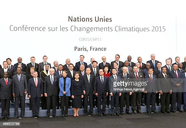 PARIS Nov 30 2015 Chinese President Xi Jinping eighth left in second row poses for a group photo with other participants during the United Nations...