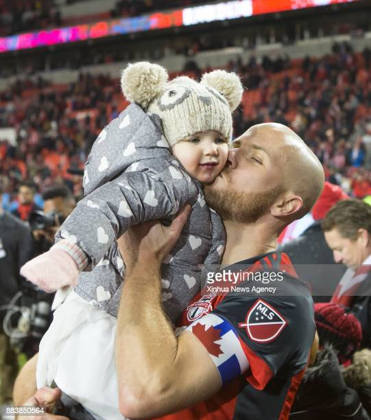 TORONTO Nov 30 2017 Michael Bradley of Toronto FC kisses his daughter after the Eastern Conference final second leg match of the 2017 Major League...