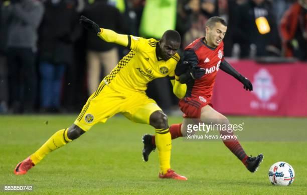 TORONTO Nov 30 2017 Sebastian Giovinco of Toronto FC vies with Jonathan Mensah of Columbus Crew SC during the Eastern Conference final second leg...