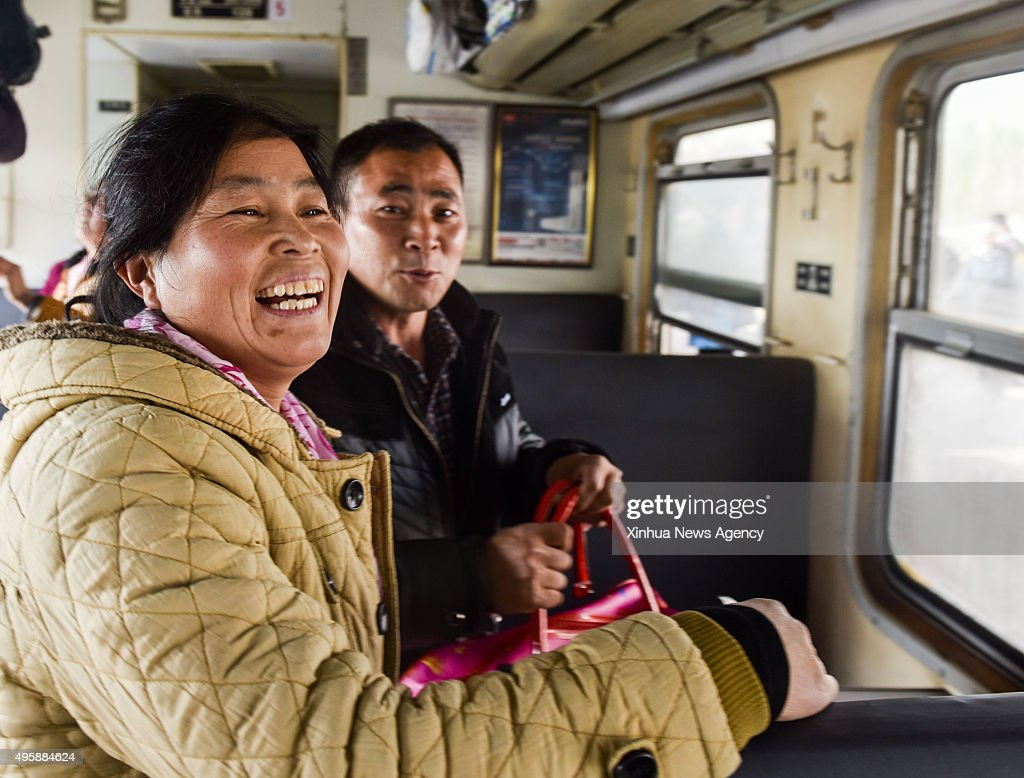 SHIHEZI Nov 5 2015 Cotton picker Gao Jinling left packs her luggages on the train in Shihezi northwest China's Xinjiang Uygur Autonomous Region Nov 5...