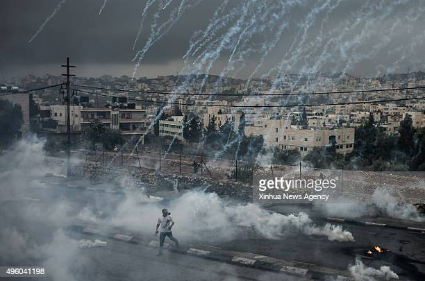 JERUSALEM Nov 6 2015 Palestinian protesters evade from a shower of tear gas cylinders shot by Israeli security forces during clashes in the West Bank...