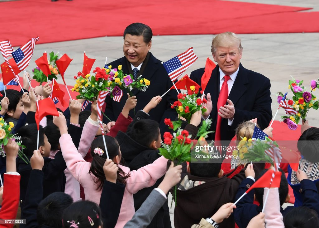 BEIJING, Nov. 9, 2017 -- Chinese President Xi Jinping (L) holds a grand ceremony to welcome U.S. President Donald Trump at the square outside the east gate of the Great Hall of the People in Beijing, capital of China, Nov. 9, 2017.