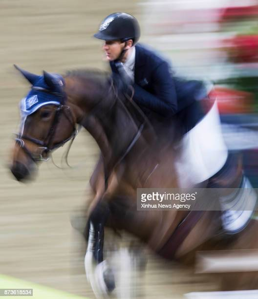 TORONTO Nov 9 2017 McLain Ward of the United States rides his horse HH Azur over an obstacle during the 2017 FEI World Cup Jumping in Toronto Nov 8...