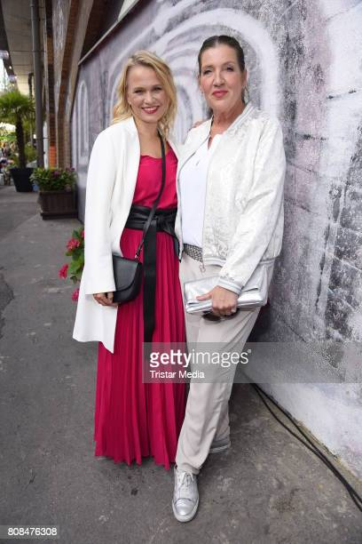 Nova Meierhenrich and Katy Karrenbauer attend the Riani Fashion Show Spring/Summer 2018 at Umspannwerk Kreuzberg on July 4 2017 in Berlin Germany