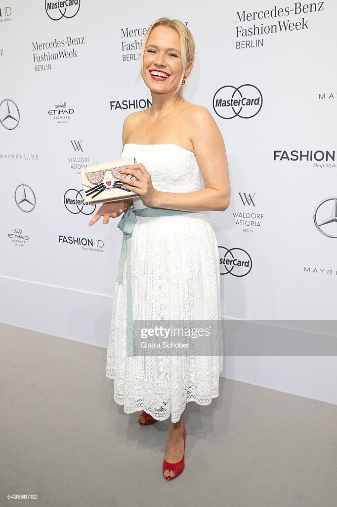 <a gi-track='captionPersonalityLinkClicked' href=/galleries/search?phrase=Nova+Meierhenrich&family=editorial&specificpeople=215062 ng-click='$event.stopPropagation()'>Nova Meierhenrich</a> wearing a white dress by Lena Hoschek during the Lena Hoschek show during the Mercedes-Benz Fashion Week Berlin Spring/Summer 2017 at Erika Hess Eisstadion on June 30, 2016 in Berlin, Germany.