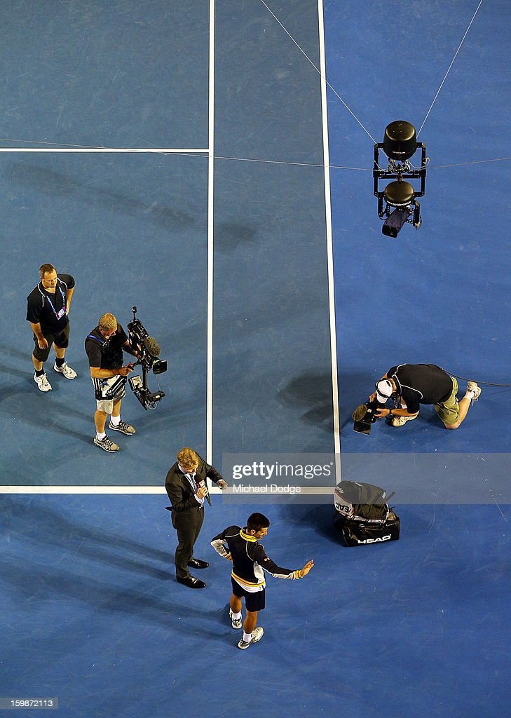 Novak Djockovic gets interviewed after his Quarterfinal match against Thomas Berdych of The Czech Republic during day nine of the 2013 Australian Open at Melbourne Park on January 22, 2013 in Melbourne, Australia.