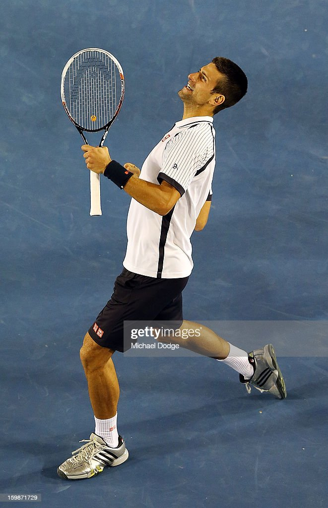 Novak Djockovic of Serbia celebrates his win in his Quarterfinal match against Thomas Berdych of The Czech Republic during day nine of the 2013 Australian Open at Melbourne Park on January 22, 2013 in Melbourne, Australia.