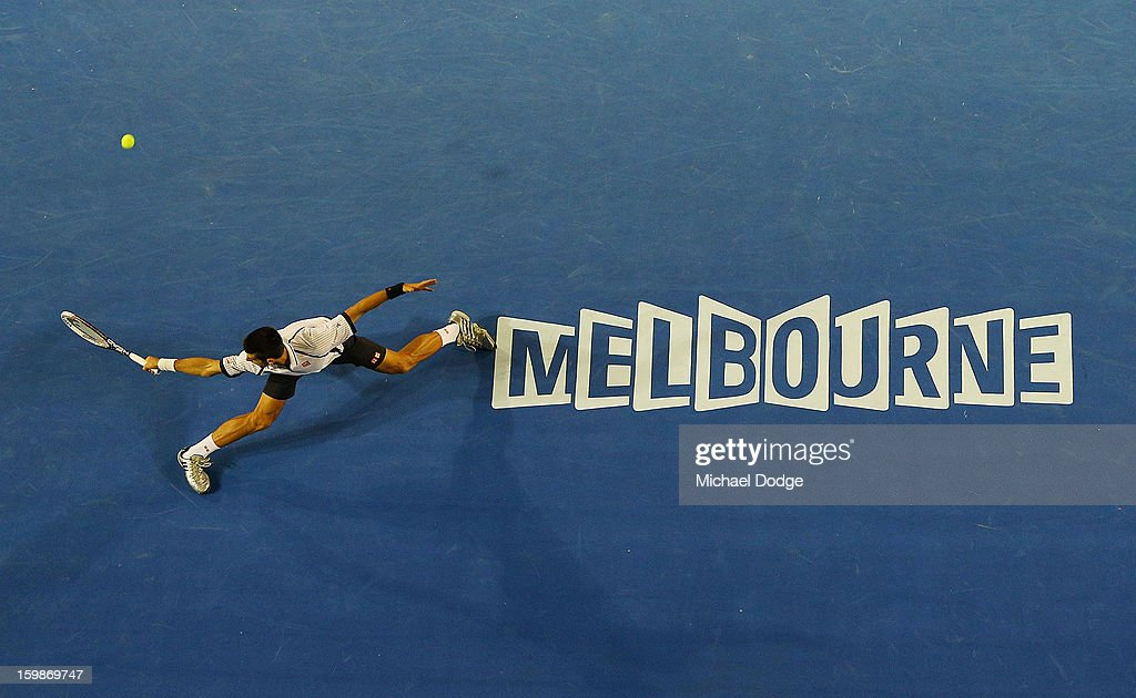 Novak Djockovic of Serbia plays a backhand in his Quarterfinal match against Thomas Berdych of The Czech Republic during day nine of the 2013 Australian Open at Melbourne Park on January 22, 2013 in Melbourne, Australia.