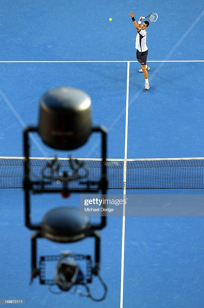 Novak Djockovic of Serbia warms up with the Spidercam in the forehground before his Quarterfinal match against Thomas Berdych of The Czech Republic during day nine of the 2013 Australian Open at Melbourne Park on January 22, 2013 in Melbourne, Australia.