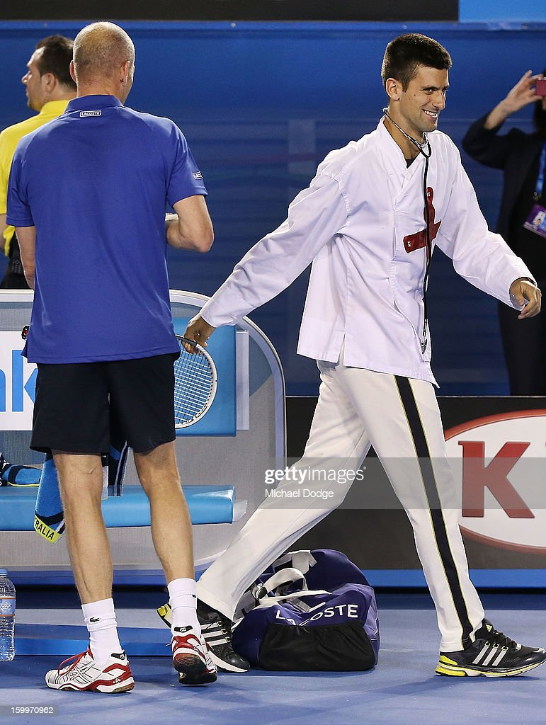 Novak Djockovic walks off after impersonating a doctor and administering treatment to Henri Leconte of France during the legends doubles match with Guy Forget of France against Pat Cash of Australia and Goran Ivanisevic of Croatia during the 2013 Australian Open at Melbourne Park on January 24, 2013 in Melbourne, Australia.