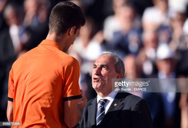 Novak Djokovic and French Tennis Federation President Jean Gachassin on day fifteen of the French Open at Roland Garros on June 7th 2015 in Paris...