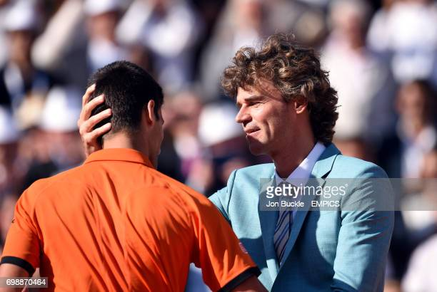 Novak Djokovic and Gustavo Kuerten on day fifteen of the French Open at Roland Garros on June 7th 2015 in Paris France