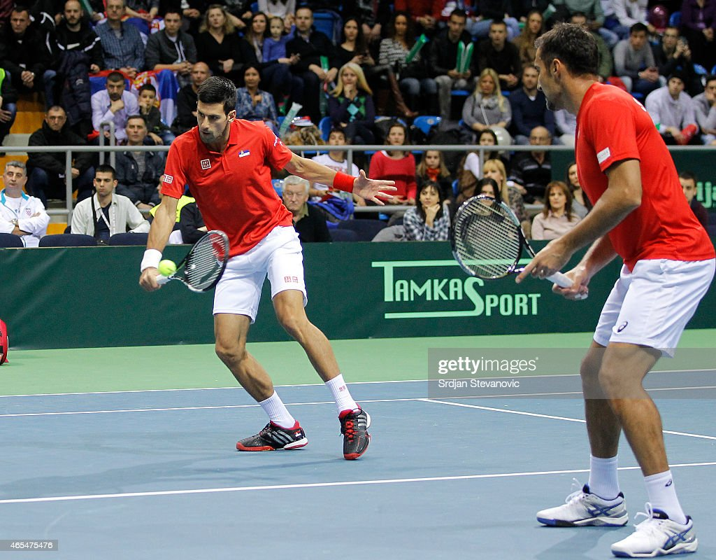 <a gi-track='captionPersonalityLinkClicked' href=/galleries/search?phrase=Novak+Djokovic&family=editorial&specificpeople=588315 ng-click='$event.stopPropagation()'>Novak Djokovic</a> (L) and <a gi-track='captionPersonalityLinkClicked' href=/galleries/search?phrase=Nenad+Zimonjic&family=editorial&specificpeople=243242 ng-click='$event.stopPropagation()'>Nenad Zimonjic</a> of Serbia in action against Marin Draganja and Franko Skugor of Croatia during their men's double match on the day two of the Davis Cup match between Serbia and Croatia on March 07, 2015 in Kraljevo, Serbia.