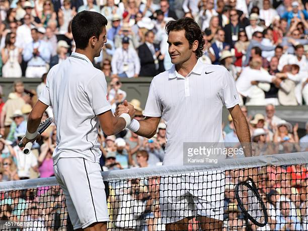 Novak Djokovic beats Roger Federer on centre court during the mens singles final of the Wimbledon Championships at Wimbledon on July 6 2014 in London...