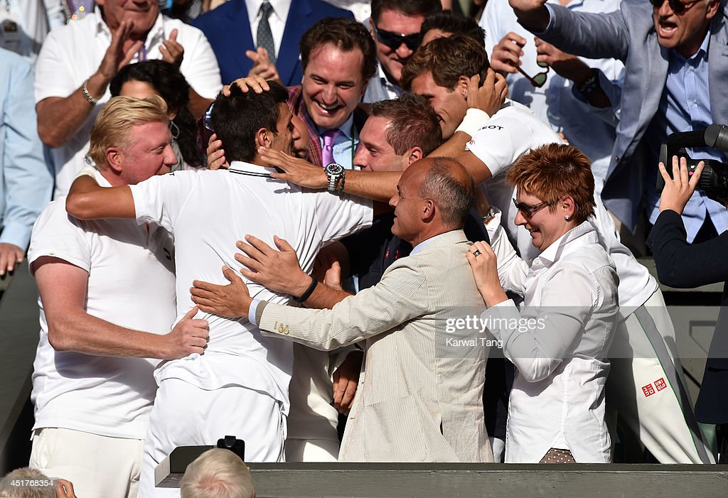 Novak Djokovic celebrates in the players box after defeating Roger Federer during the mens singles final at the Wimbledon Championships at Wimbledon on July 6, 2014 in London, England.