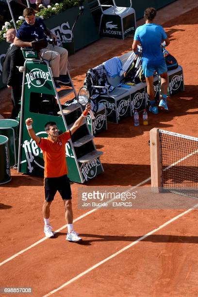 Novak Djokovic celebrates victory against Rafael Nadal in the Men's Singles Quarterfinals on day eleven of the French Open at Roland Garros on June 3...