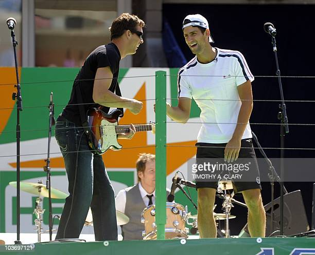 Novak Djokovic from Serbia sings with the Bryan Brothers band during the Arthur Ashe Kids Day at the USTA Billie Jean King National Tennis Center in...