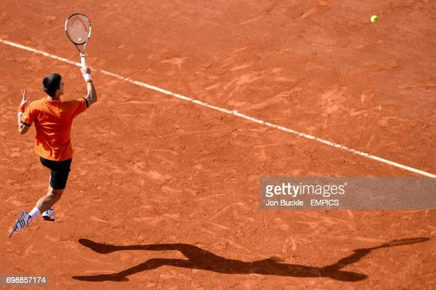 Novak Djokovic in action against Rafael Nadal in the Men's Singles Quarterfinals on day eleven of the French Open at Roland Garros on June 3 2015 in...
