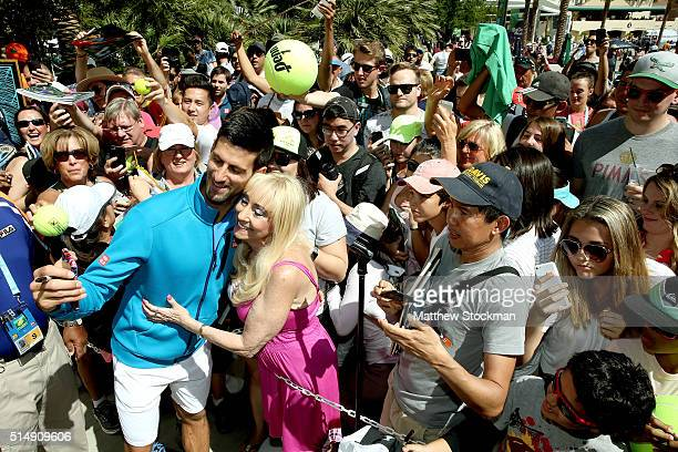 Novak Djokovic of Sebia signs autographs during the BNP Paribas Open at the Indian Wells Tennis Garden on March 11 2016 in Indian Wells California