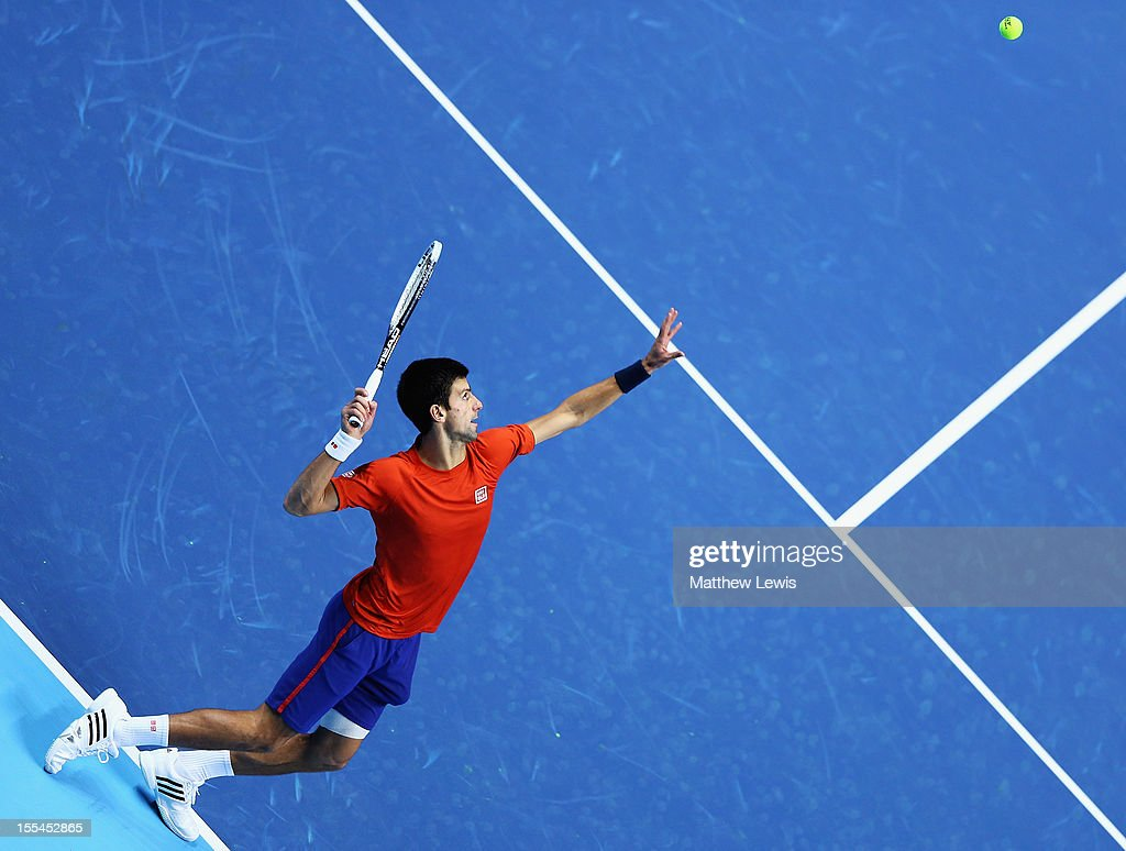 Novak Djokovic of Serbai warms up against Juan Martin del Portro of Argentina during previews for the ATP World Tour Finals at the O2 Arena on November 4, 2012 in London, England.
