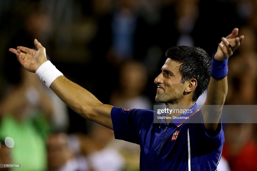 <a gi-track='captionPersonalityLinkClicked' href=/galleries/search?phrase=Novak+Djokovic&family=editorial&specificpeople=588315 ng-click='$event.stopPropagation()'>Novak Djokovic</a> of Serbia acknowledges the crowd after defeating Florian Mayer of Germany during the Rogers Cup at Uniprix Stadium on August 6, 2013 in Montreal, Quebec, Canada.